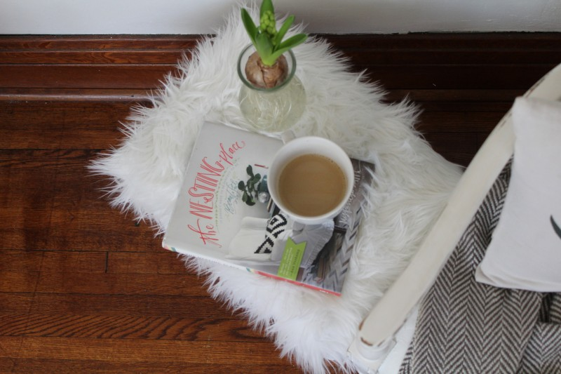 Faux fur footstool styled with the Nesting Place