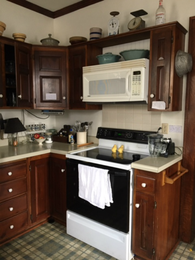 These kitchen cabinets had to go - come see the transformation!