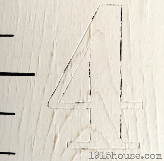 No need for a stencil on this project - trace your growth chart number outlines and fill in with paint!