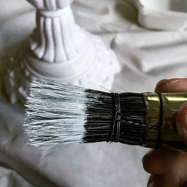 A big old stencil brush works great to get into all the nooks and crannies of a curvy table lamp.