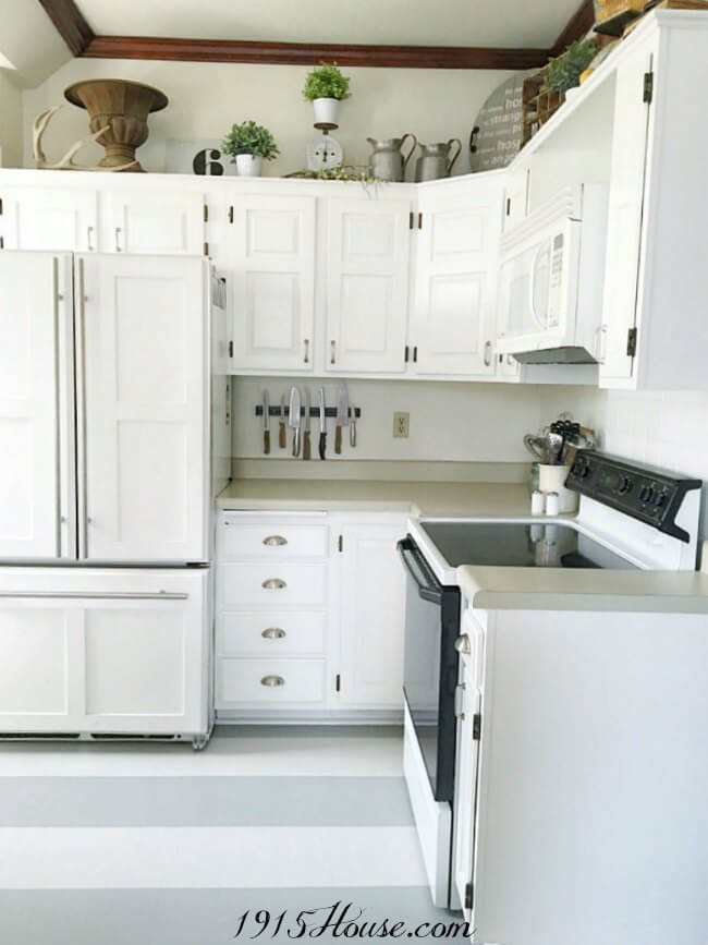 Using ONLY paint, check out how this kitchen was completely refreshed for under $200! Including cabinets and floors!