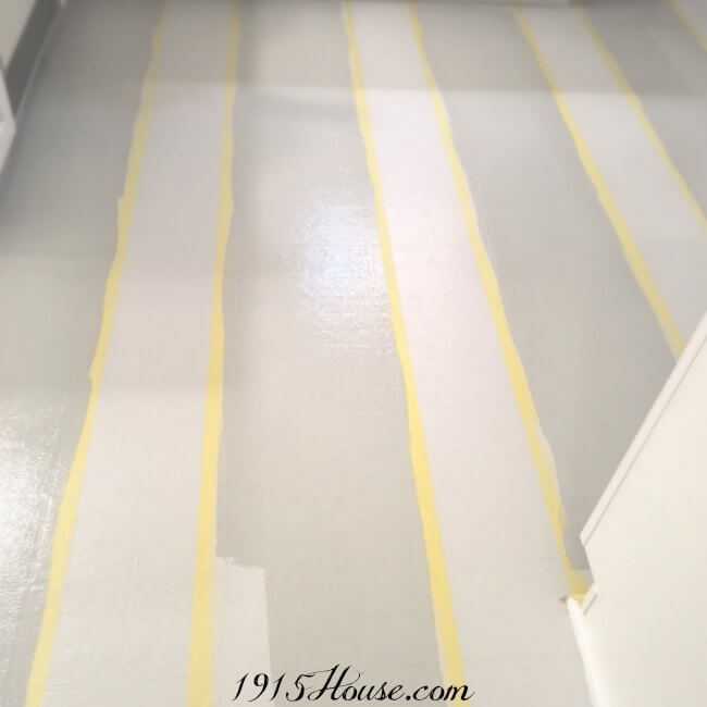 Floors taped off and stripes being painted on....one of the highest-impact updates we've done in our house...and for UNDER $100!
