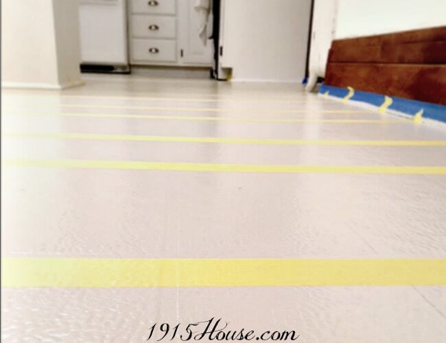 Tape applied and floors ready for paint-