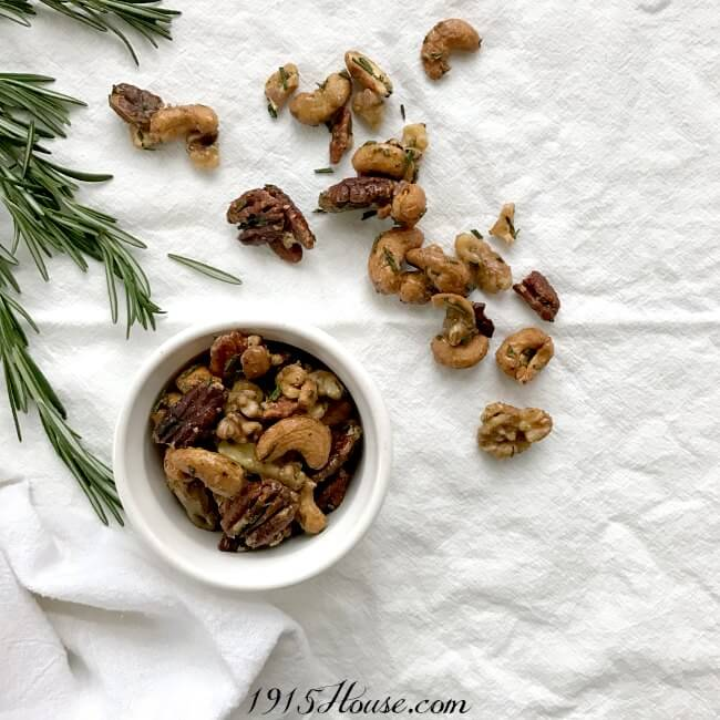 So easy. So addictive. Sweet and Spicy Rosemary Roasted Nuts - quick recipe to throw together the next time I need to take an appetizer somewhere (or just to snack on)!