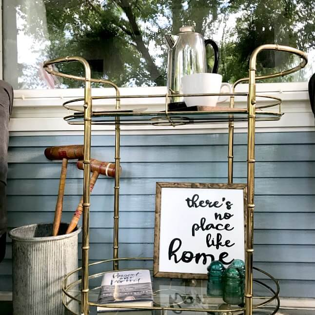 Thrifted bar cart serves as a great serving piece on a front porch. | how to make the most of thrifted finds |