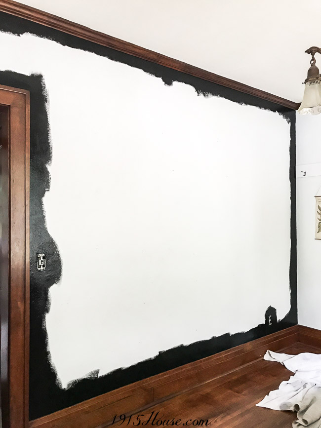 The beginning of painted black walls in the dining room