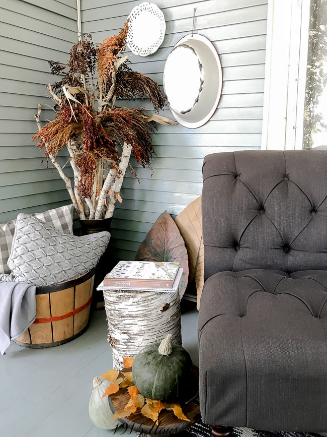 Organic elements like broom corn and birch branches give you texture and color for your Fall front porch