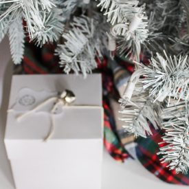 A beautiful white Christmas tree brightens up your home - save money by DIYing your own!